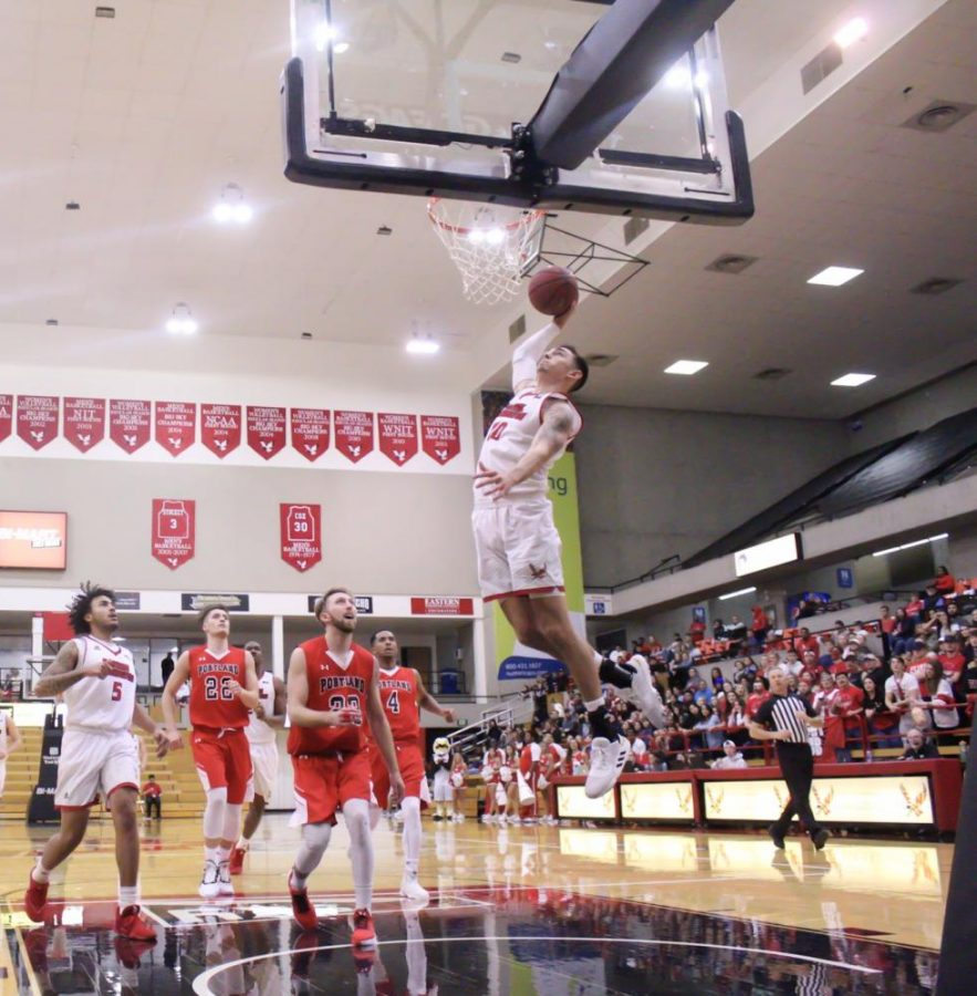 EWU+junior+guard+Jacob+Davison+soars+in+for+a+dunk.+Davison+led+all+scorers+with+15+points+in+EWUs+107-25+victory+over+Portland+Bible+College+Tuesday.
