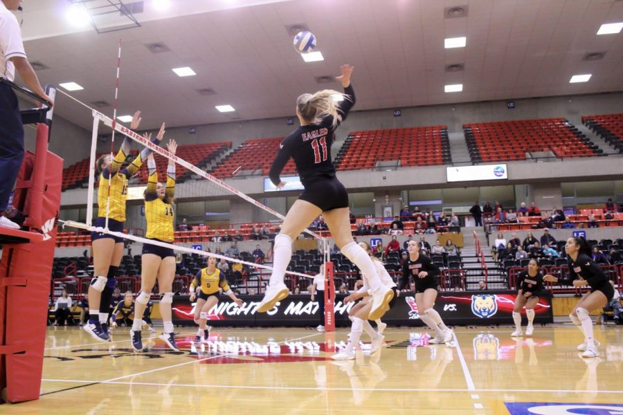 EWU junior outside hitter MaKenna Davis attempts a kill. Davis led EWU with eight kills in the Eagles' three-set loss to UNC Saturday.