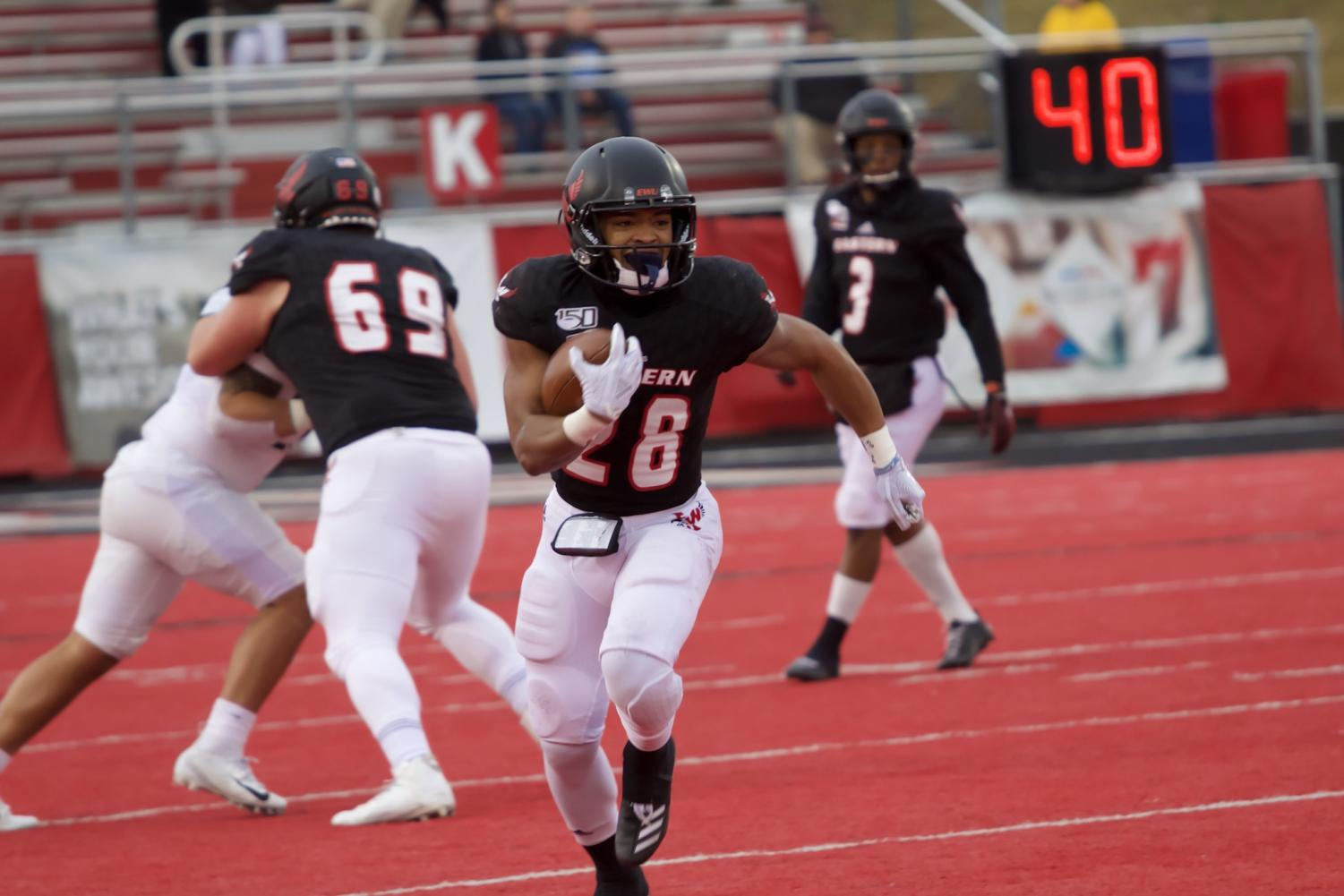 EWU senior running back Antoine Custer Jr. cuts in the open field. Custer had a career-high 218 rushing yards and two touchdowns in EWU's 53-46 win over PSU Saturday.