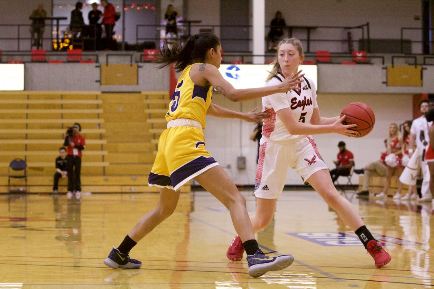 EWU freshman guard Jenna Dick looks to pass to the post. Dick got the start at point guard Sunday and responded by scoring a career-high 17 points.