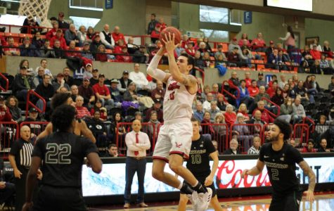 EWU junior guard Jacob Davison attacks the basket. Davison scored 26 points in EWU's 71-69 victory over PSU Saturday.