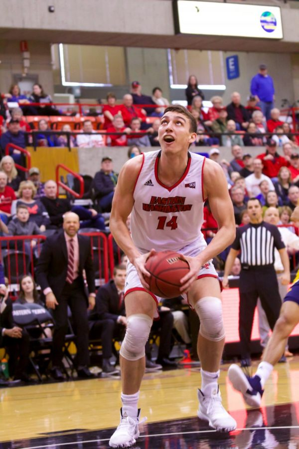 EWU senior forward Mason Peatling goes up for a putback layup. Peatling scored 27 points and grabbed 15 rebounds in EWU's 80-70 win over NAU Saturday.