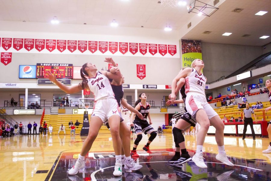 EWU sophomore center Bella Cravens (left, No. 14) and freshman forward Milly Knowles (right, No. 21) battle for a rebound. Cravens had 20 points and 16 rebounds in EWU's 70-67 loss to Southern Utah Thursday.