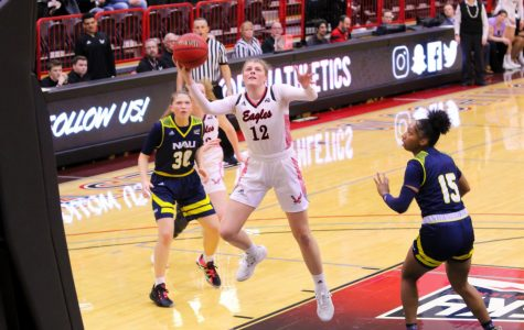 EWU freshman wing Kennedy Dickie soars to the rim. Dickie scored 16 points and grabbed a career-high 14 rebounds in EWU's 70-62 loss to NAU Monday.