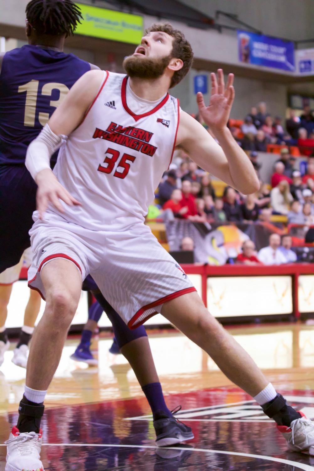 EWU sophomore forward Tanner Groves boxes out for a rebound. Groves scored 16 points in EWU's 74-45 win over MSU Saturday.