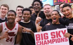 The EWU men's basketball team celebrates its Big Sky regular season title. EWU clinched the title with a 78-69 victory over Weber State Saturday.