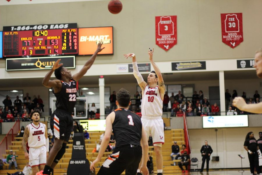 EWU junior guard Jacob Davison launches a three. Davison led EWU with 23 points Thursday.