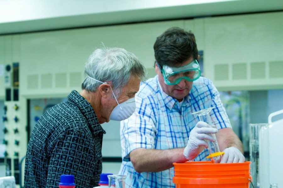 Biochemistry+professor+Jeff+Corkill+%28left%29+and+lab+manager+Fred+Joslin+%28right%29+prepare+%22Eagle+Sanitizer.%22