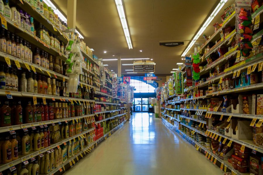 An aisle of the Cheney Safeway. Most grocery stores, including this one, have measures in place to encourage social distancing.