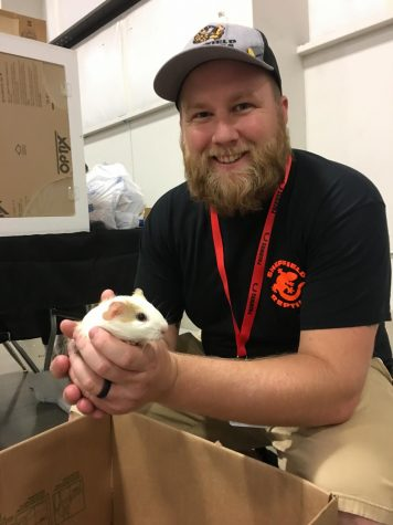 Hunter Sheffield holding a guinea pig for Sheffield Reptiles.