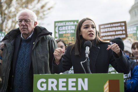 UNITED STATES - NOVEMBER 14: Sen. Bernie Sanders, D-Vt., and Rep. Alexandria Ocasio-Cortez, D-N.Y., along with affordable housing advocates and climate change activists announce the introduction of public housing legislation as part of the Green New Deal outside the Capitol on Thursday, November 14, 2019. (Photo By Bill Clark/CQ-Roll Call, Inc via Getty Images)