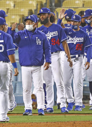 LOS ANGELES, CALIFORNIA - MARCH 30: The Los Angeles Dodgers celebrate their 6-4 win over the Los Angeles Angels on March 30, 2021 in Los Angeles, California. (Photo by Meg Oliphant/Getty Images)